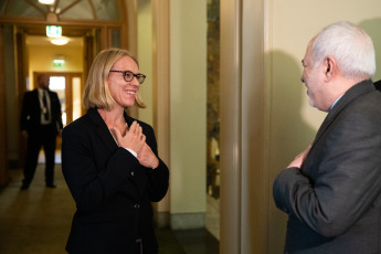 The President of the Committee for Foreign Affairs and Defense of the Norwegian Parliament (left), Anniken Huitfeldt welcomes the Minister of Foreign Affairs of Iran, Javad Zarif (right).